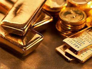 Gold price edges lower, strong dollar weighs