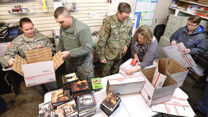 Pawn America donates gifts to deployed 312th members