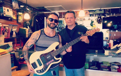 Man buys stolen bass guitar at pawn shop, returns it to owner